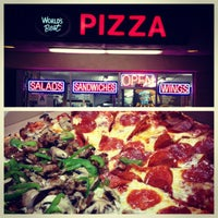 Photo taken at Worlds Best Pizza by Josh O. on 11/29/2012