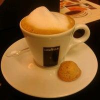 Photo taken at Café Hum by Teresa J. on 5/9/2013