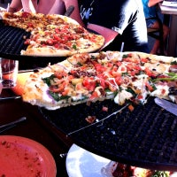 Photo taken at Kaleidoscope Pizzeria & Pub by Travel Medford on 7/25/2013