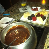 Photo taken at The Melting Pot by Hillary on 3/13/2013