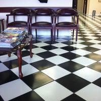 Photo taken at Gino's Classic Barber Shoppe by Kurt P. on 3/4/2014