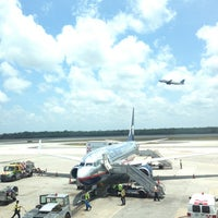 Photo taken at Cancún International Airport (CUN) by Denisse on 5/9/2013