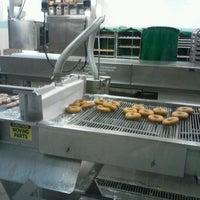 Photo taken at Krispy Kreme Doughnuts by Stephanie M. on 10/26/2012