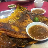 Photo taken at Sungai Yu Seafood Restaurant by angel y. on 11/29/2013