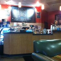 Photo taken at Land of a Thousand Hills Coffee House by ed s. on 3/23/2013