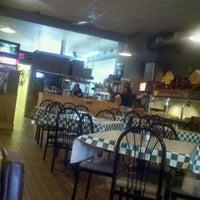 Photo taken at Grace's Place Pizza by Samy V. on 8/21/2011