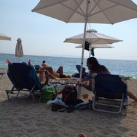 Photo taken at Ακτή του Ήλιου by Marios L. on 8/4/2012