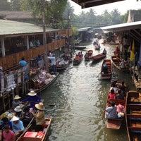 Photo taken at Damnoen Saduak Floating Market by Tach on 2/15/2013