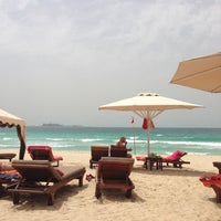Photo taken at Madinat Jumeirah Private Beach by Ирина Е. on 4/24/2013