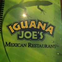Photo taken at Iguana Joe's by Joey on 12/6/2012