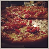 Photo taken at Andolini's Pizzeria by Tad L. on 10/16/2013