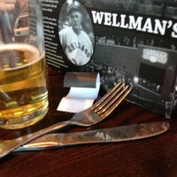 Photo taken at Wellman's Pub & Rooftop by Katie E. on 7/11/2013