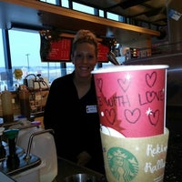 Photo taken at Starbucks by Melanie G. on 12/12/2012