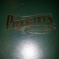 Photo taken at Pizzalley's Pizzeria by Lucie A. on 6/13/2013