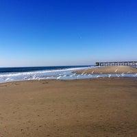 Photo taken at Isle of Palms Beach by Sarah G. on 3/11/2014