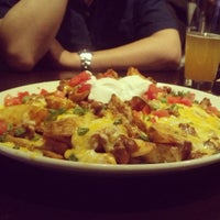 Photo taken at BJ's Restaurant and Brewhouse by James A. on 3/27/2013