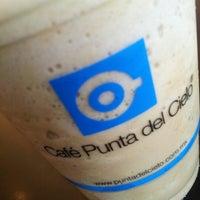 Photo taken at Cafe Punta del Cielo by Mr. L. on 10/21/2012