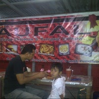 Photo taken at Naufal Fried Chicken And Burger Crispy by Rei Khyie K. on 7/2/2013