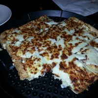 Photo taken at Portobello Pizza & Grill by Tyler H. on 1/24/2013