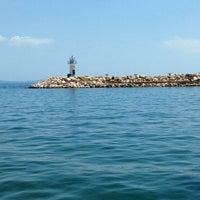 Photo taken at Küçükkuyu Plajı by Serenay Keskin Sözeri on 5/25/2013