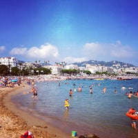 Photo taken at Plage de la Croisette by Keyvan M. on 7/28/2013