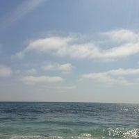 Photo taken at Anita Street Beach by Serj I. on 6/7/2015