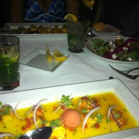 Photo taken at Ola Restaurant by Carolyne G. on 9/17/2012