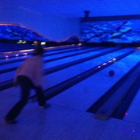 Photo taken at Cosmic Bowling by Serap on 2/8/2013