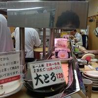Photo taken at 天下寿司 高田馬場店 by Masanori T. on 7/18/2013