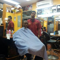 Photo taken at Boom Champions Barber Salon by Selvyn K. on 9/27/2012
