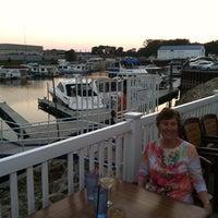 Photo taken at Huck Finn's on the Water by Dan Christensen on 9/27/2013