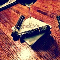 Photo taken at Jamie's Cigar Bar & Restaurant by Houst D. on 3/12/2014
