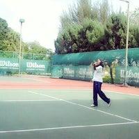 Photo taken at Gelanggang Tennis Tasik Titiwangsa by Mia H. on 10/14/2013