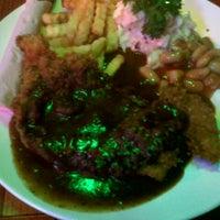 Photo taken at Western Food Chicken Chop Uptown by Erzmelissa Z. on 11/11/2012