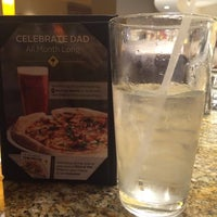 Photo taken at California Pizza Kitchen by Amy N. on 6/9/2014