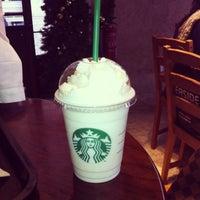 Photo taken at Starbucks by Ana B. on 12/19/2012