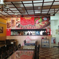 Photo taken at Artisans Pizza by Allan Q. on 10/12/2013