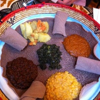 Photo taken at Queen of Sheba Ethiopian Cuisine by Rio Ty T. on 4/14/2013