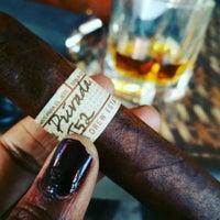 Photo taken at Elite Cigar Cafe by Dana on 10/3/2015