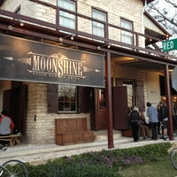 Photo taken at Moonshine Patio Bar & Grill by Bastian B. on 3/11/2013