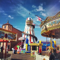 Photo taken at Brighton Palace Pier by Victor-kun on 5/12/2013