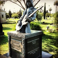 Photo taken at Hollywood Forever Cemetery by Rufi G. on 7/13/2013