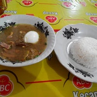 Photo taken at Soto Madura Cak Udin by Andi A. on 1/10/2014