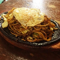 Photo taken at お好み焼き吉香 by yazzzz on 7/18/2015