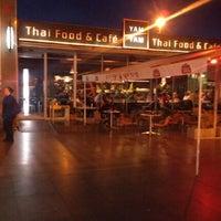 Photo taken at YAM YAM Thai Food & Café by Tereza D. on 10/8/2012