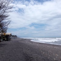 Photo taken at Pantai Kuwaru by Alninda H. on 1/31/2015