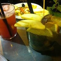 Photo taken at Yguana Café by OzAlt on 11/18/2013