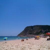 Photo taken at Praia de Itacoatiara by Rafael R. on 1/1/2013