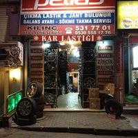 Photo taken at kınıç oto lastik ve tamir by Olgun.y on 2/5/2014
