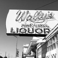 Photo taken at Wally's Mills Avenue Liquors by Arturo M. on 3/16/2013